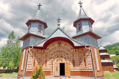 Wooden orthodox church Saints Peter and Paul, Carlibaba village, Romania Stock Photos