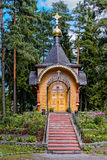 Wooden orthodox church in forest Stock Photography