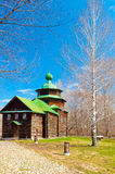 Wooden orthodox church with green roof Stock Photo