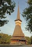 Wooden orthodox church raising through forest royalty free stock photos