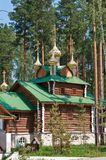 Wooden orthodox church among the trees Royalty Free Stock Photography