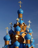 Wooden Orthodox Church With Blue Domes Stock Photo