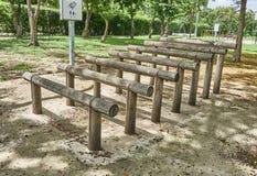 Wooden outdoor exercise equipment. Stock Photos