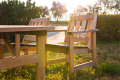 Wooden outdoor furniture. Lounge chairs in hotel garden invite you to relax Stock Photo