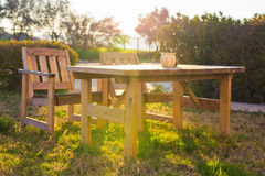 Wooden outdoor furniture. Lounge chairs in hotel garden invite you to relax Royalty Free Stock Photos