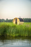 Wooden outdoor sauna by the lake in summer Royalty Free Stock Photos