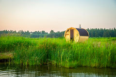 Wooden outdoor sauna by the lake in summer Stock Image