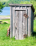 Wooden outhouse. Old wooden outhouse by the river Royalty Free Stock Photos