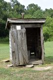 Wooden outhouse in field, Georgia, USA Stock Image