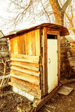 Wooden outhouse Stock Photo