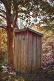 Wooden Outhouse Privy in the Woods stock images
