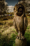 Wooden Owl. Spring time Owl sculpture, carved wood Royalty Free Stock Photo