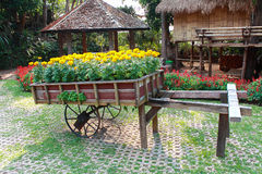 Wooden oxcart with flowers Royalty Free Stock Images
