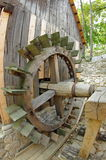 Water mill. Traditional wooden paddle wheel - Romania Stock Photo