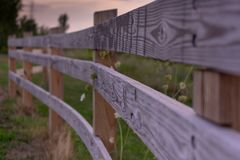 Wooden Paddock Fence with Three Railings royalty free stock photos