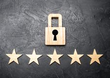 A wooden padlock and five stars. Security, security of users and business. Internet security, antivirus, data protection royalty free stock image