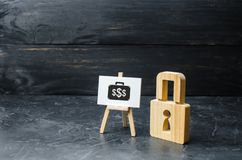 Wooden padlock and sign with the image of investment. Protection money concept. Safe and secure investment, insurance. stock images