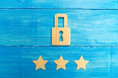Wooden padlocks and three stars. Security, security of users and business. Internet security, antivirus, data protection. Alarms o. F home, car and business. The royalty free stock photography