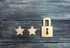 Wooden padlocks and three stars. Security, security of users and business. Internet security, antivirus, data protection. Alarms o. F home, car and business. The royalty free stock images