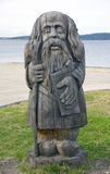 Wooden pagan idol. Great handwork is the stylized wooden pagan idol in Russia. Karelia, Onego lake Royalty Free Stock Images