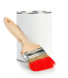 Wooden paint brush with paint tin close-up on white background. Royalty Free Stock Photo