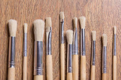 Wooden paint brushes on table background Royalty Free Stock Images