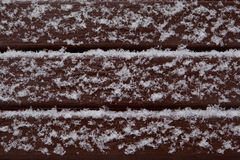 Wooden painted boards covered with snow Stock Photo