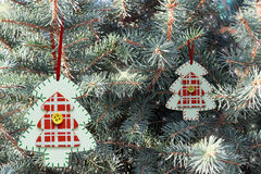 Wooden painted Christmas tree on a blue tree. the concept of new Royalty Free Stock Photo