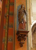 Wooden painted medieval Saint statue. Old wooden painted statue of a Saint in the Catholic Gothic Brussels Kapelle-church stock images