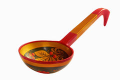 Wooden painted spoon Khokhloma. Wooden spoon is painted with a Khokhloma isolated on a white background Stock Image