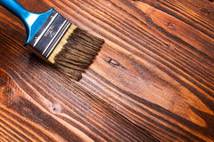 Wooden painting. Varnishing a wooden shelf using paintbrush Royalty Free Stock Image