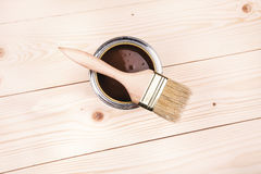 Wooden painting. Varnishing a wooden shelf using paintbrush Stock Photos