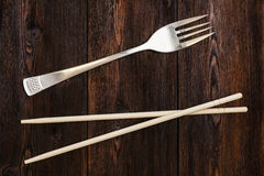 Free Wooden Pairs Of Chopsticks Vs Fork. Abstract Conceptual Image Stock Images - 77767474
