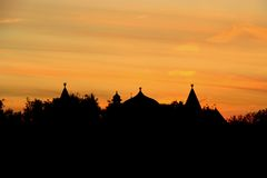 Wooden palace roofs at sunset royalty free stock images