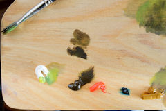 Wooden Palette With Oil-Based Paints Royalty Free Stock Photo