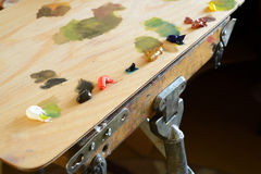 Wooden Palette With Oil-Based Paints Stock Images