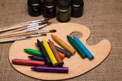 Wooden palette with pencils Stock Images