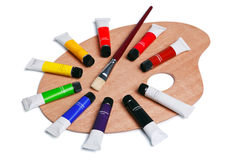 Wooden palette with tubes of paint isolated Stock Photos