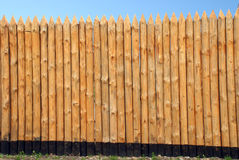Wooden paling. From the sharp raw logs Stock Photos