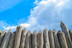 Wooden palisade on the background of blue sky Stock Photo