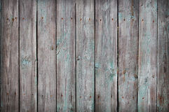 Wooden Palisade background. Close up of grey and green wooden fence panels. Stock Image