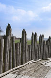 Wooden palisade. Medieval wooden palisade in sunny day Stock Image