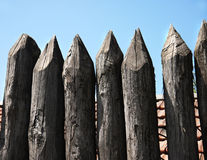 Wooden palisade of the protective fence Royalty Free Stock Photos