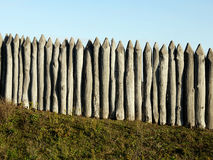 Wooden palisade of the protective fence Royalty Free Stock Image
