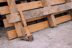 Wooden pallet and adze. Outside Stock Photo