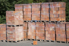 Wooden pallet with bricks. Stock Photo