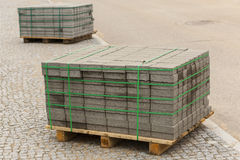 Wooden pallet with concrete bricks. Royalty Free Stock Photos