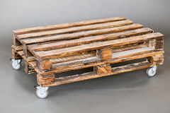 The wooden pallet. Handmade on the gray floor Stock Photography