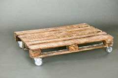 The wooden pallet. Handmade on the gray floor Royalty Free Stock Photo
