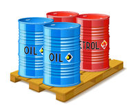 Wooden pallet and metal barrels with oil and petrol. Stock Photos